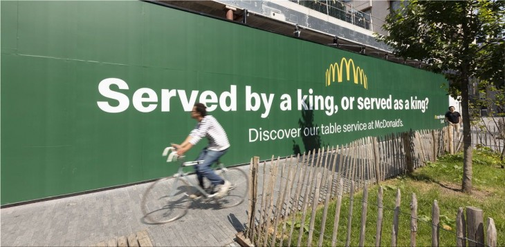"McDonald's ""Served by a king, or served as a king?"""